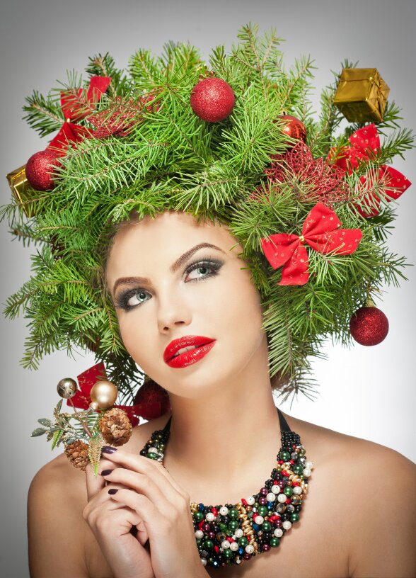 Beautiful woman with a Christmas tree for hair