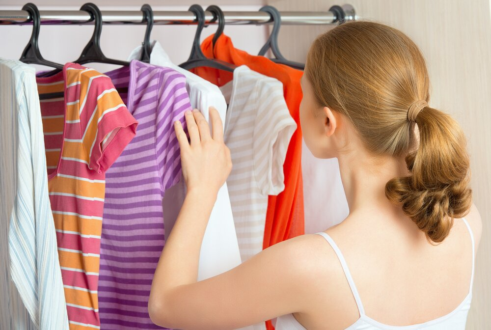 Woman examining what to wear.