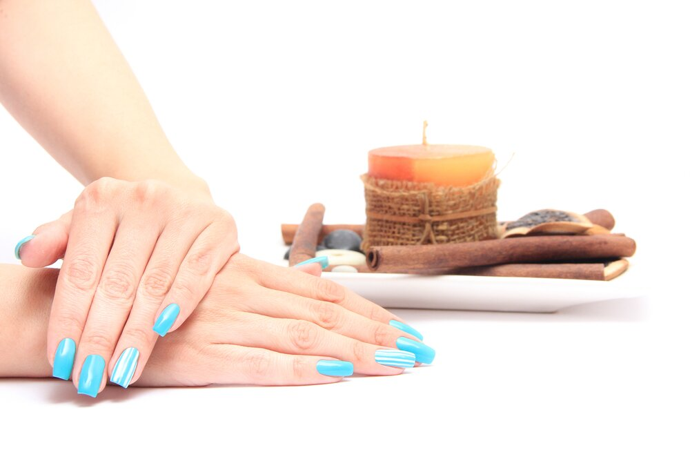 Woman with neon colored nails.