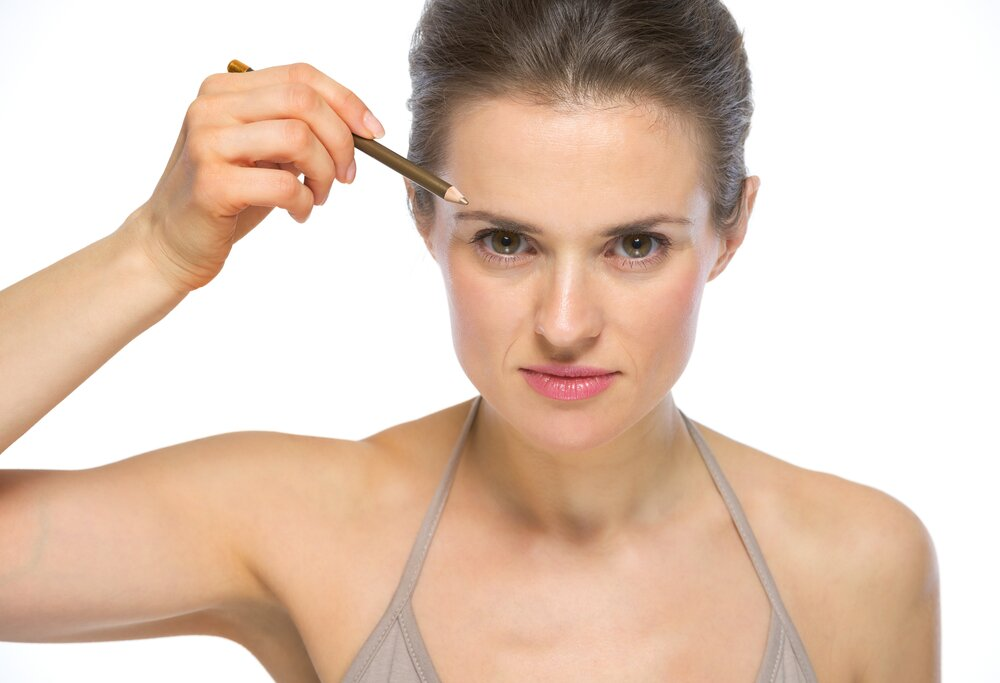 Woman using a brow pencil