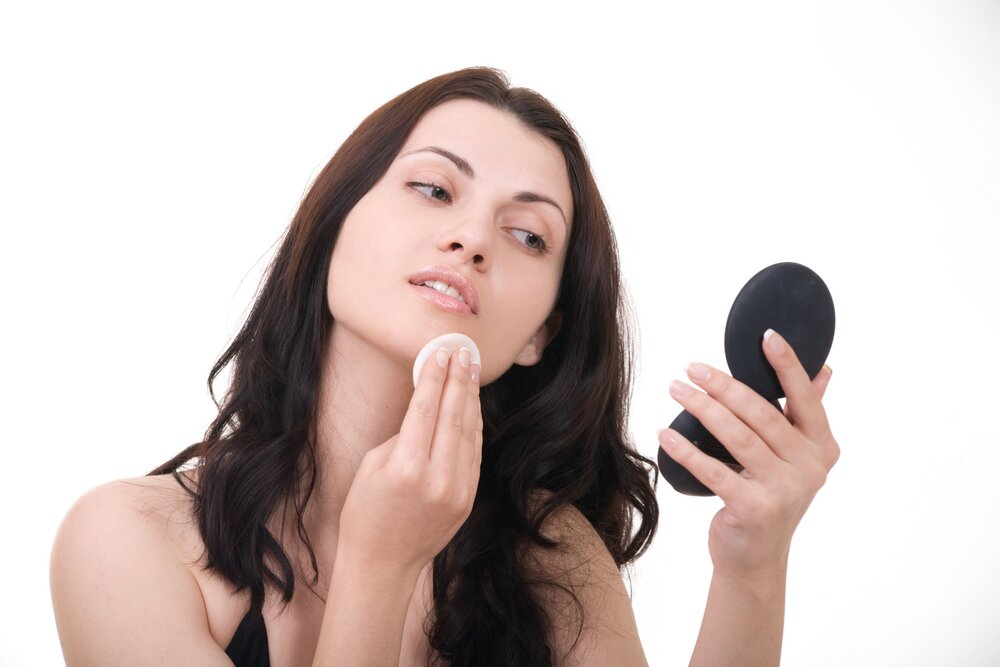 Woman treating her zit.