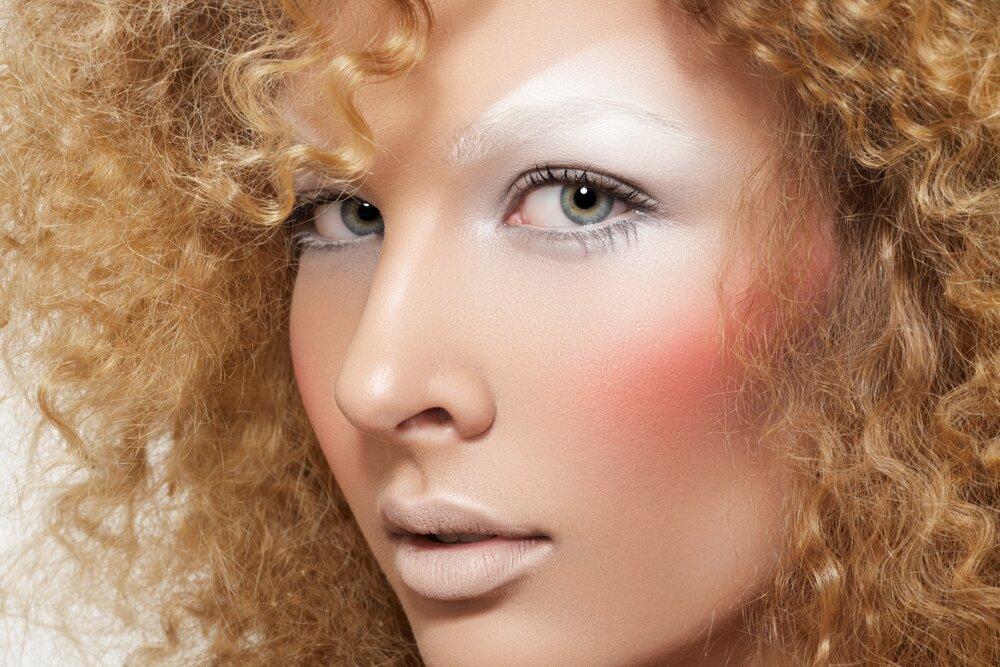 Woman with rogue makeup.
