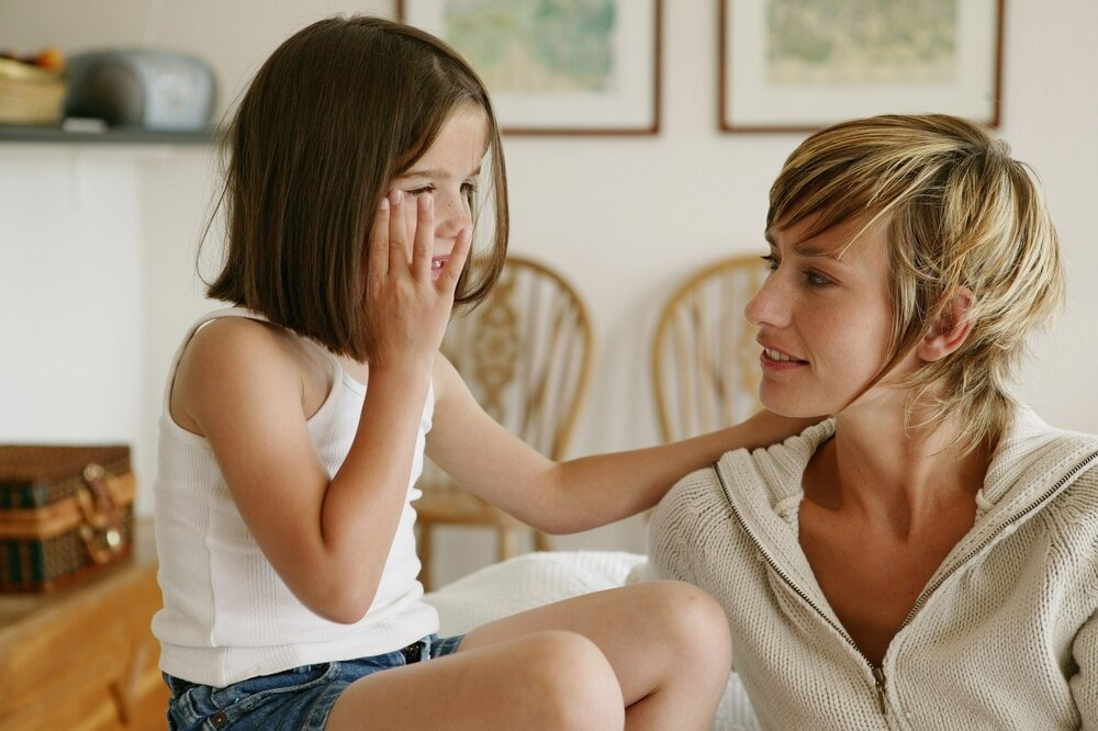 Young girl talking to her mother.