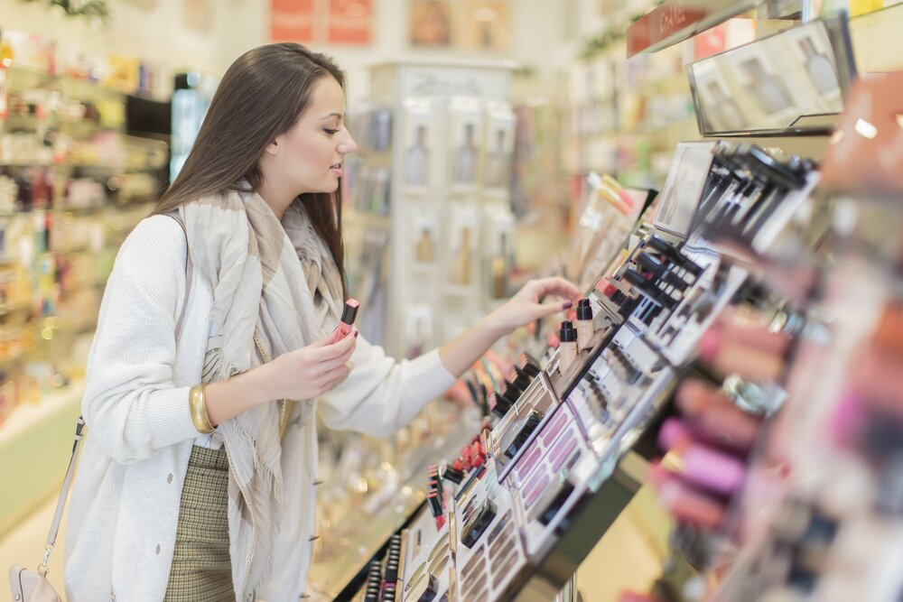 Women shopping for cosmetics.
