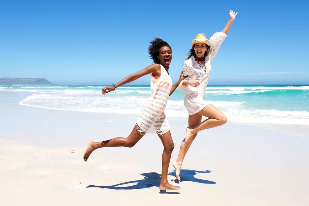 Two women having fun at the beach